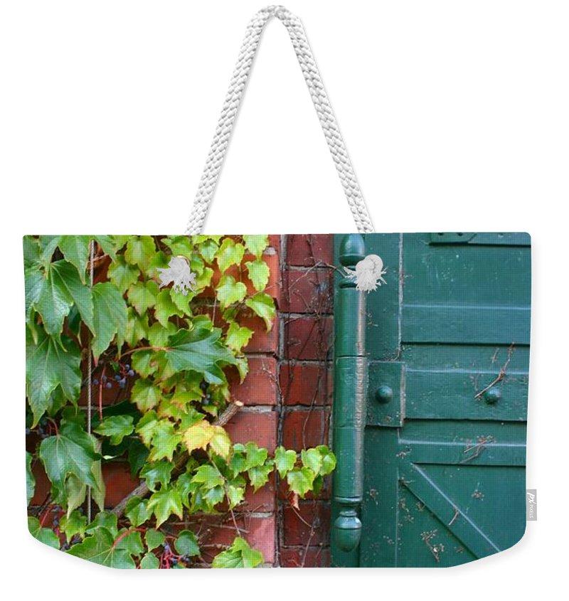 Vines Weekender Tote Bag featuring the photograph Enter Vine Door by Minaz Jantz