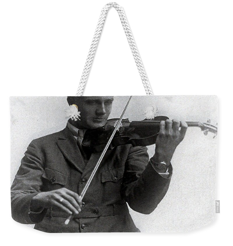 Old Photo Black And White Classic Saskatchewan Pioneers History Fiddle Violin Weekender Tote Bag featuring the photograph Entertainer by Andrea Lawrence
