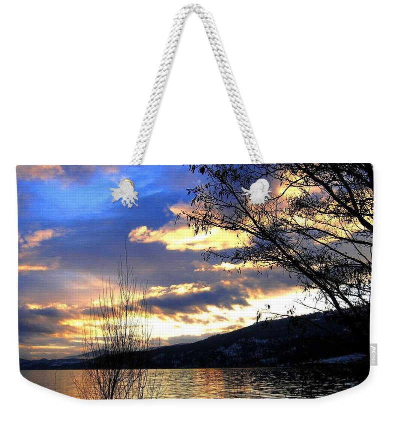 Sunset Weekender Tote Bag featuring the photograph Evening Exhibition by Will Borden