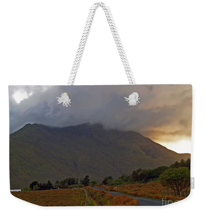 Fine Art Photography Weekender Tote Bag featuring the photograph Every Cloud Has A Silver Lining by Patricia Griffin Brett