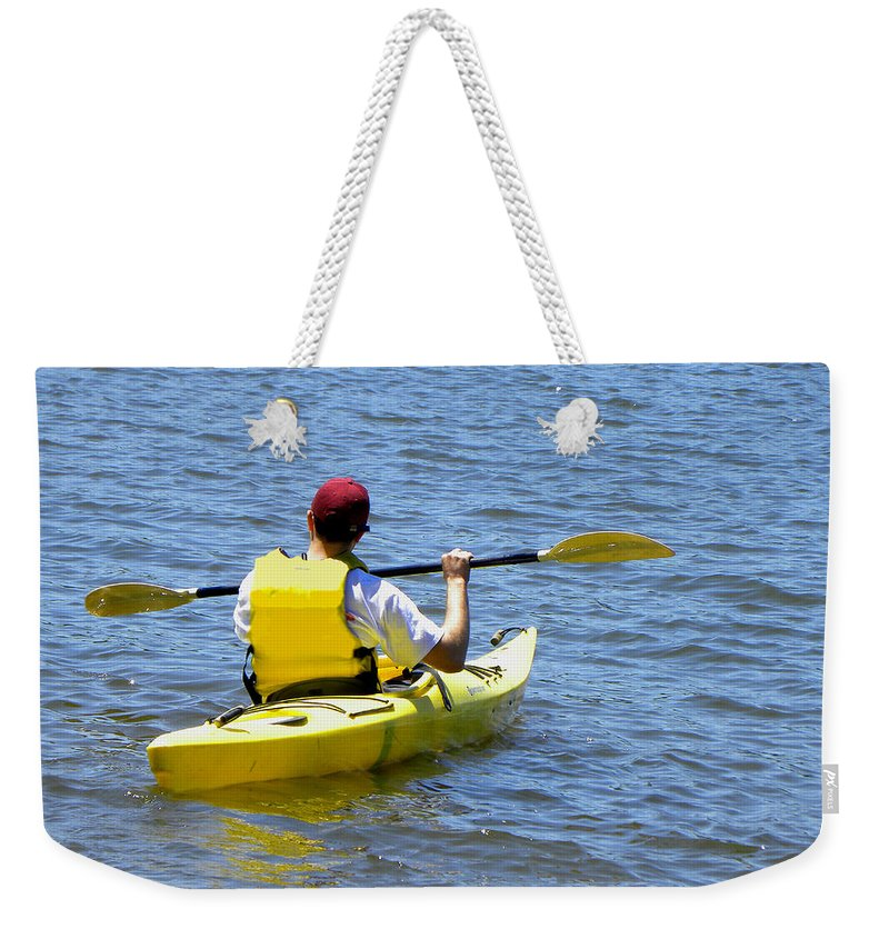 Kayak Weekender Tote Bag featuring the photograph Exploring In A Kayak by Sandi OReilly