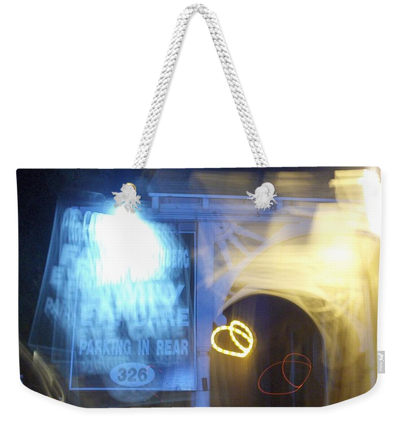 Photograph Weekender Tote Bag featuring the photograph Eye Doctor by Thomas Valentine