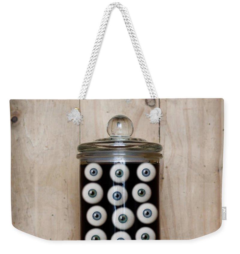 Eye. Eyes. Jar Weekender Tote Bag featuring the photograph Eyes In A Jar by Clayton Bastiani