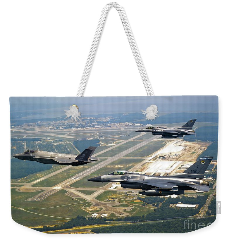Transportation Weekender Tote Bag featuring the photograph F-35 Lightning II Aircraft In Flight by Stocktrek Images