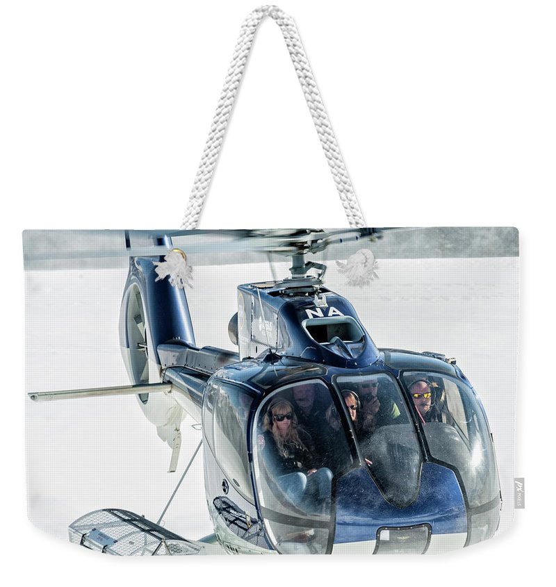 Eurecuil Weekender Tote Bag featuring the photograph F-hana Eurocopter Ec-130 Helicopter Landing by Roberto Chiartano