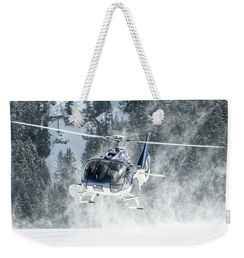 Eurecuil Weekender Tote Bag featuring the photograph F-hana Eurocopter Ec-130 Landing Helicopter At Courchevel by Roberto Chiartano