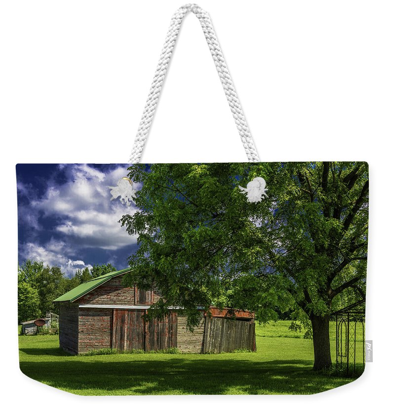 Michigan Weekender Tote Bag featuring the photograph Faded Red by Joseph Yvon Cote