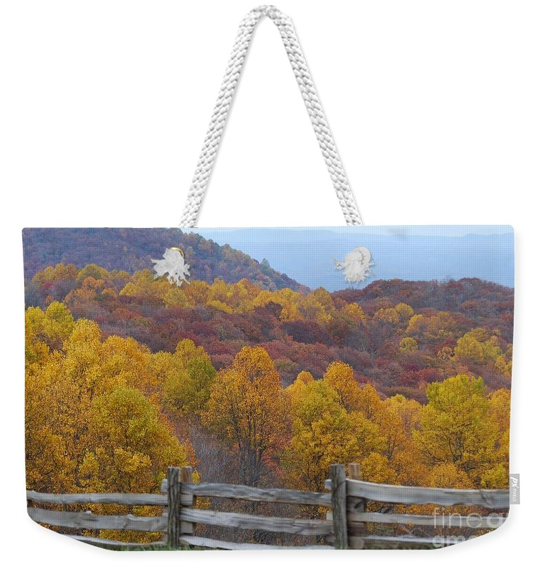 Fence Weekender Tote Bag featuring the photograph Fall Blend by Eric Liller