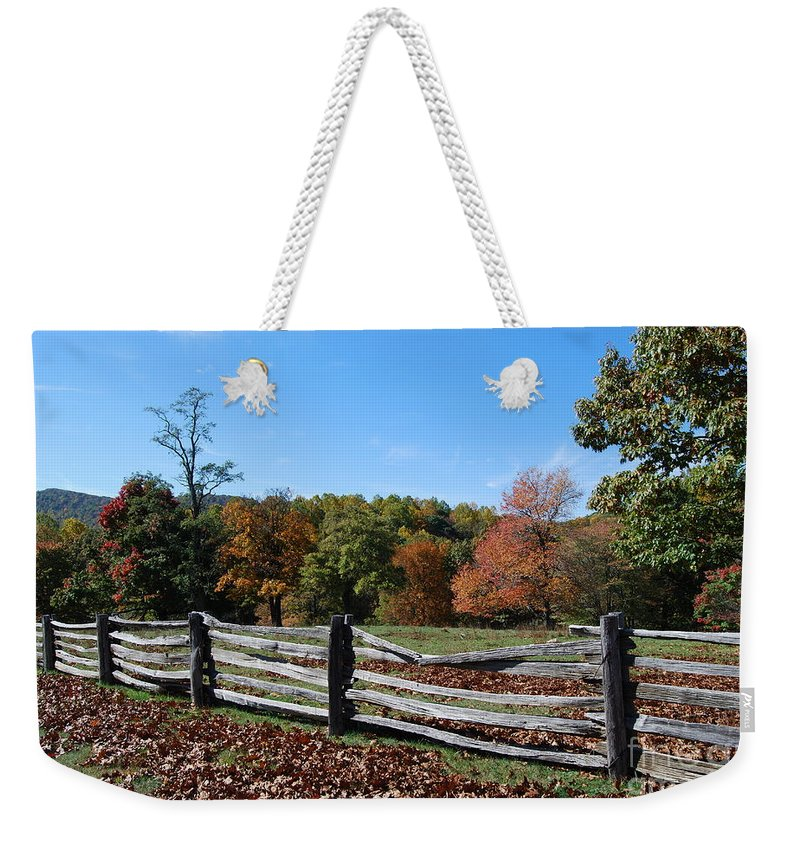 Rural Weekender Tote Bag featuring the photograph Fall Fence by Eric Liller
