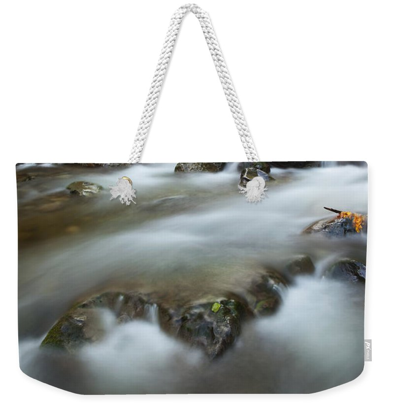Stream Weekender Tote Bag featuring the photograph Fall Surge by Mike Dawson