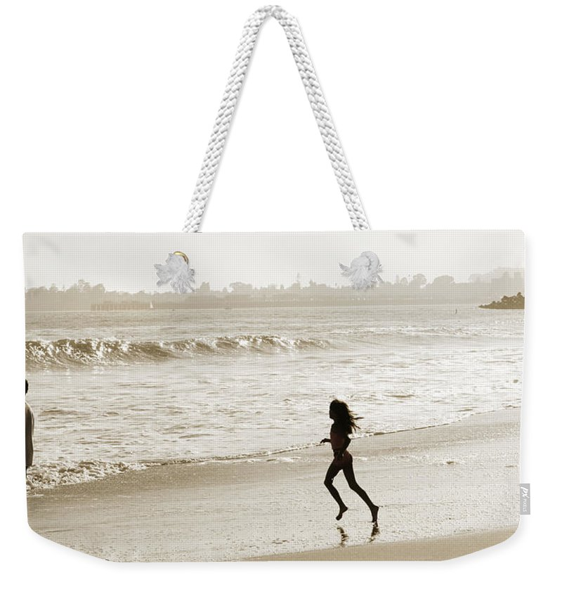 Family Weekender Tote Bag featuring the photograph Family At Play On Beach by Marilyn Hunt