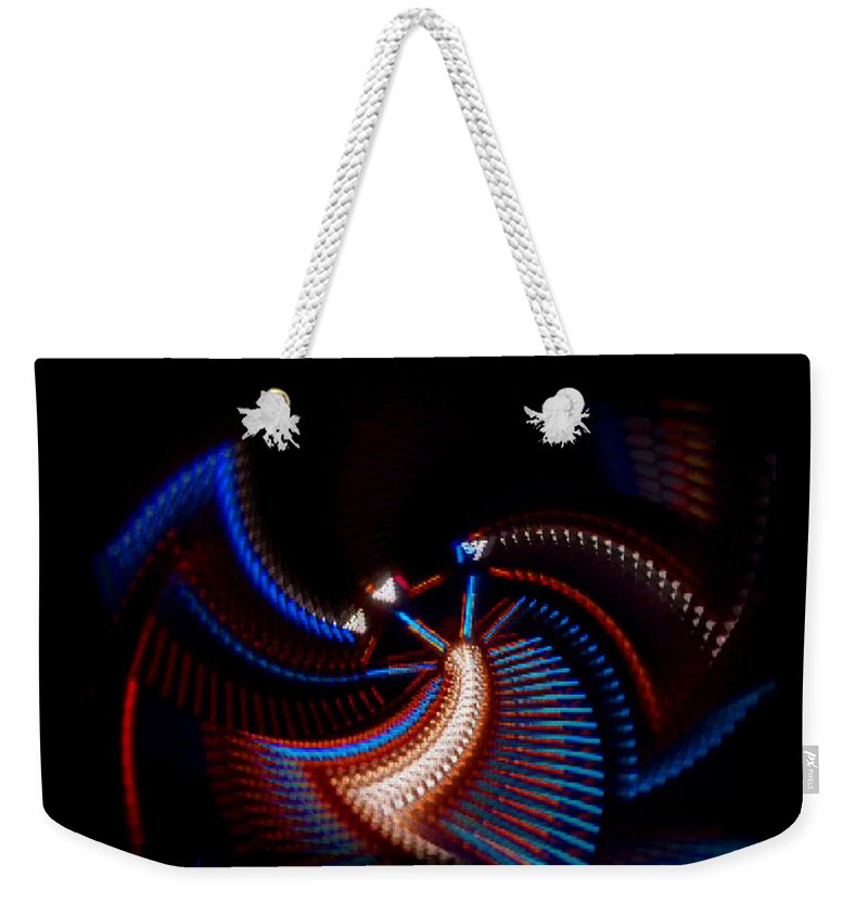 Chaos Weekender Tote Bag featuring the photograph Fan Dance by Charles Stuart
