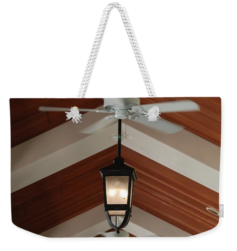 Fans Weekender Tote Bag featuring the photograph Fans And Lights by Rob Hans