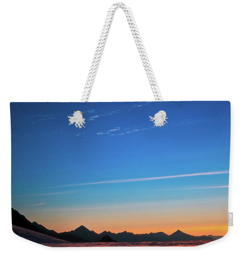 Alone Weekender Tote Bag featuring the photograph Far Mountains by Konstantin Dikovsky