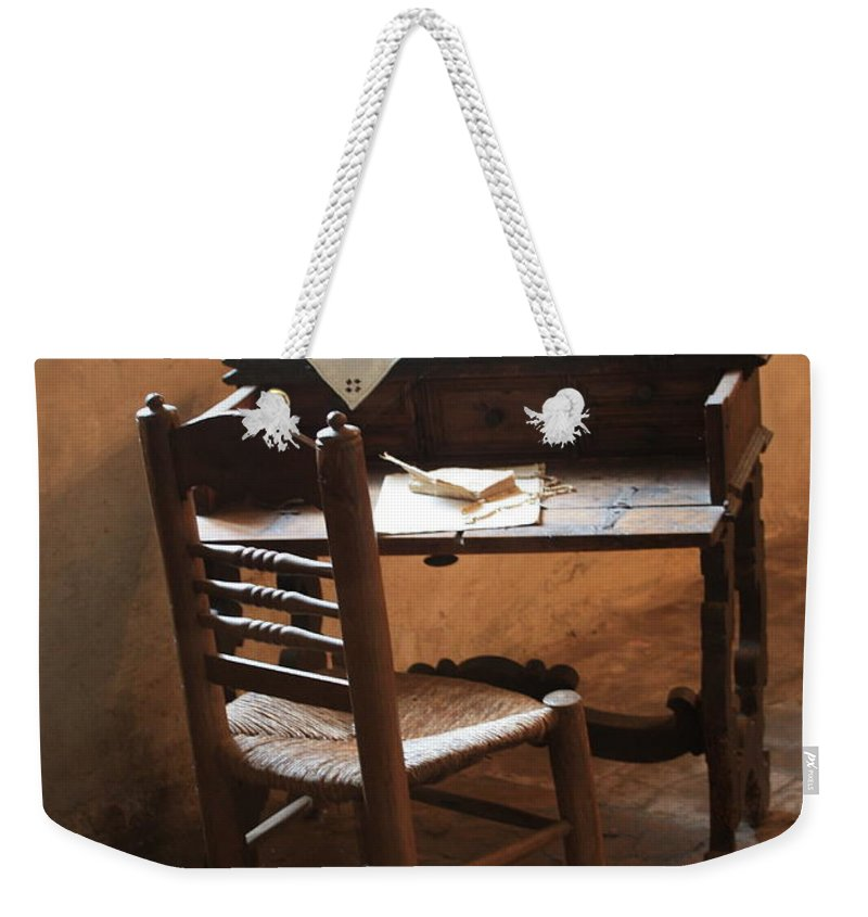 Carmel Mission Weekender Tote Bag featuring the photograph Father Serra's Desk by Carol Groenen