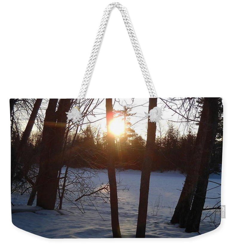 Sunrise Weekender Tote Bag featuring the photograph February Sunrise Alongside A Tree by Kent Lorentzen