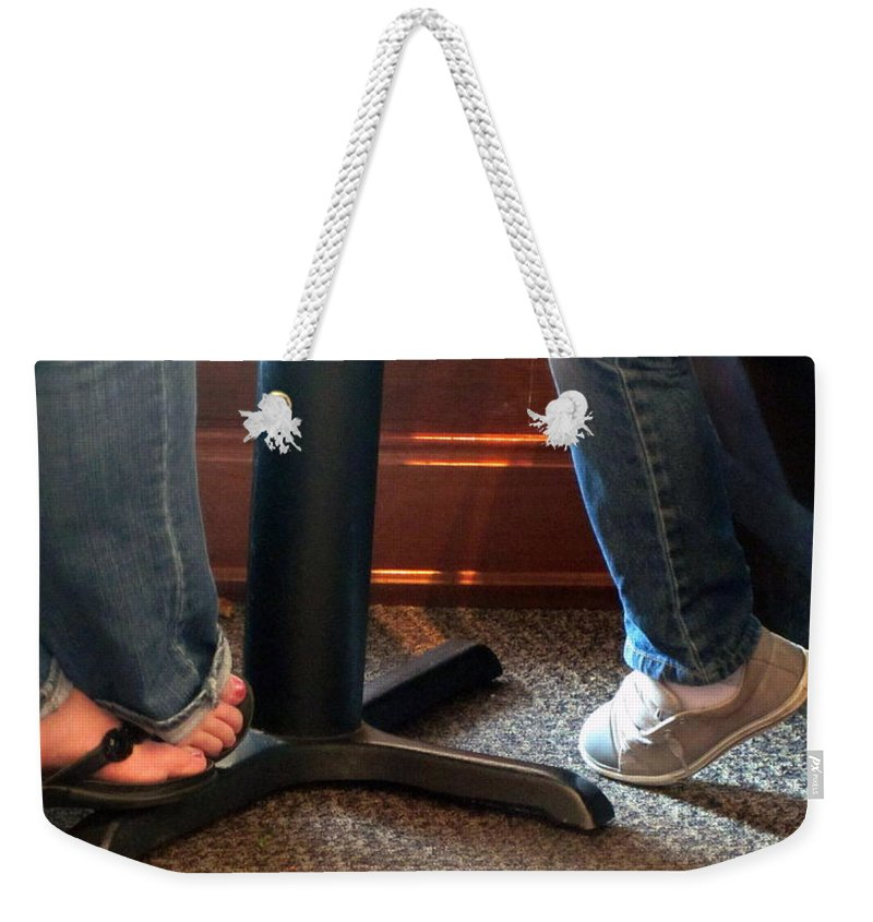 Feet Weekender Tote Bag featuring the photograph Feet In A Booth by Amy Hosp