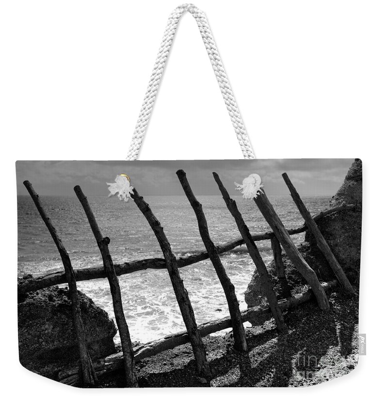 Atlantic Ocean Weekender Tote Bag featuring the photograph Fence by Gaspar Avila