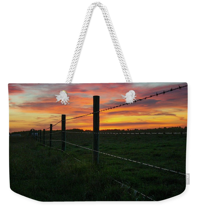 Landscapes Weekender Tote Bag featuring the photograph Fencline Sunset by Shelly Priest