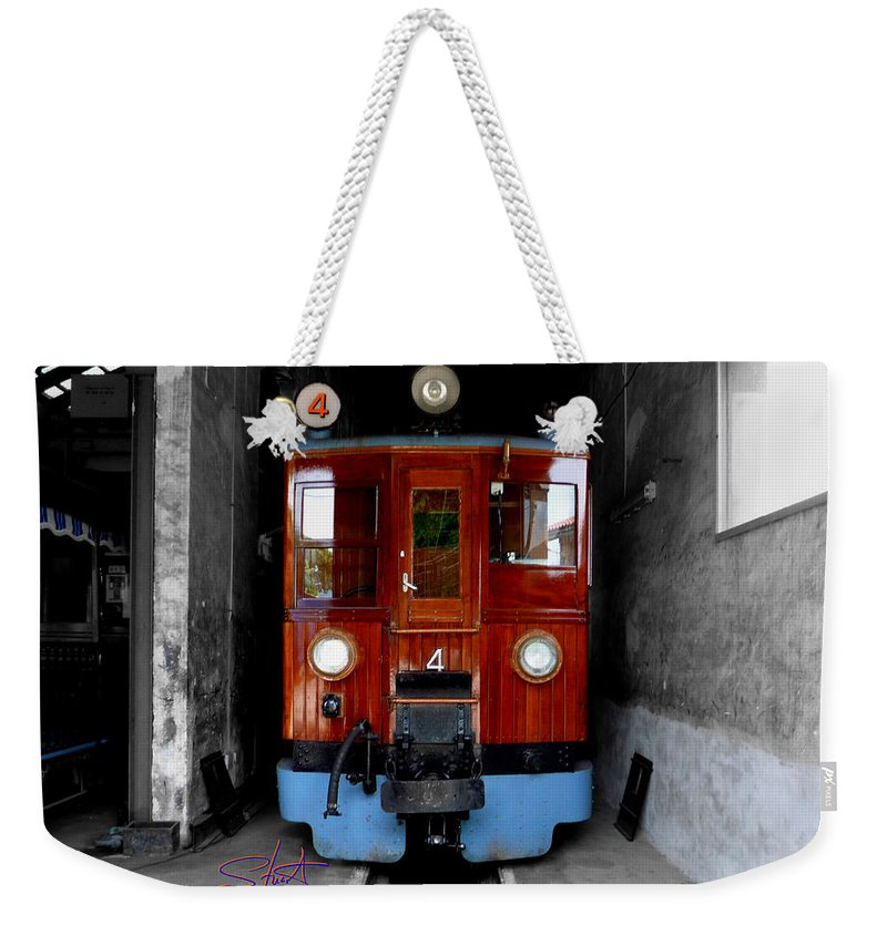 Train Weekender Tote Bag featuring the photograph Ferrocarrril De Soller by Charles Stuart