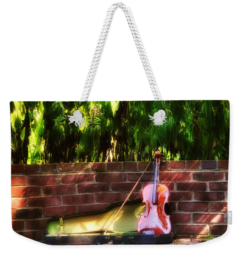 Violin Weekender Tote Bag featuring the photograph Fiddle On The Garden Wall by Bill Cannon