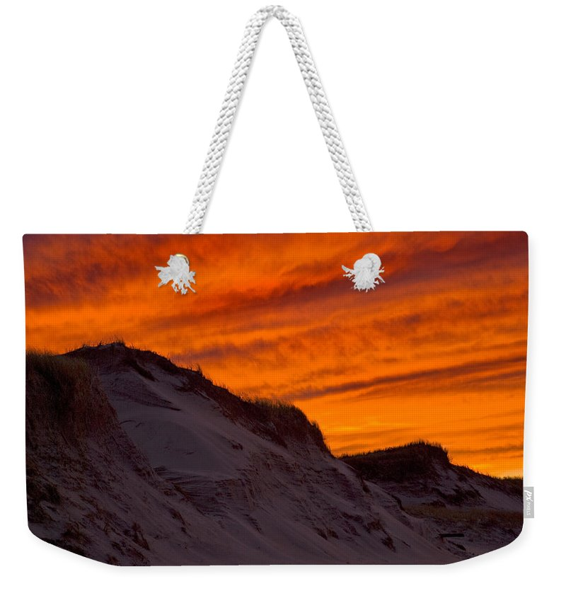 Fire Weekender Tote Bag featuring the photograph Fiery Sunset Over The Dunes by Charles Harden