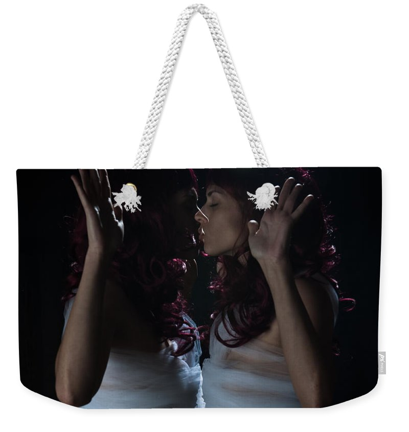 Kissing Weekender Tote Bag featuring the photograph Finding Oneself On The Other Side by Scott Sawyer