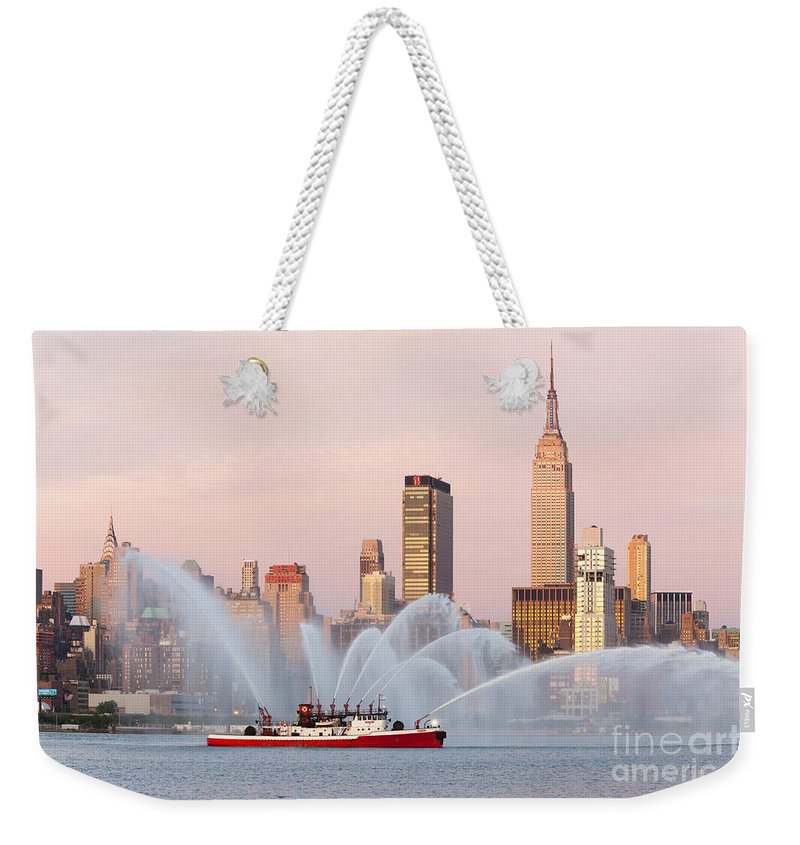 Clarence Holmes Weekender Tote Bag featuring the photograph Fire Boat And Manhattan Skyline I by Clarence Holmes