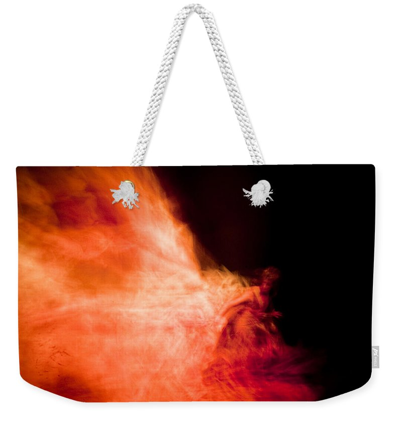 Fire Weekender Tote Bag featuring the photograph Fire Dance by Scott Sawyer