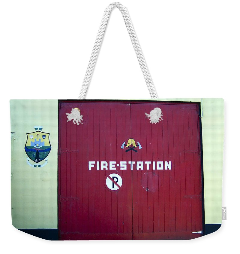 Irish Weekender Tote Bag featuring the photograph Fire Door in Macroom Ireland by Teresa Mucha