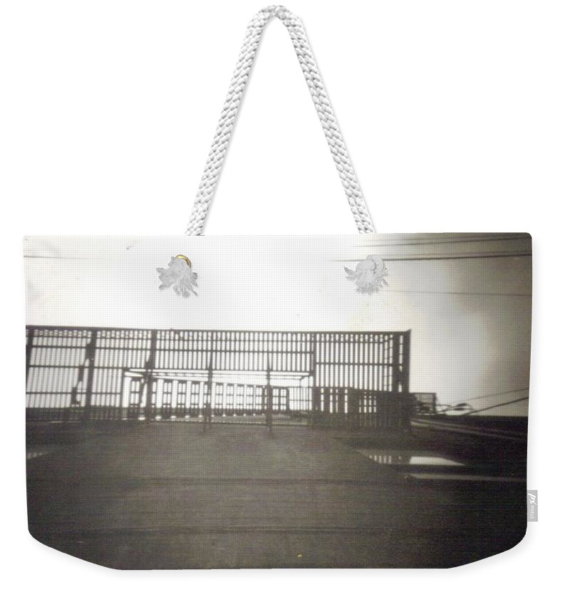 Black And White Photograph Weekender Tote Bag featuring the photograph Fire Escape by Thomas Valentine