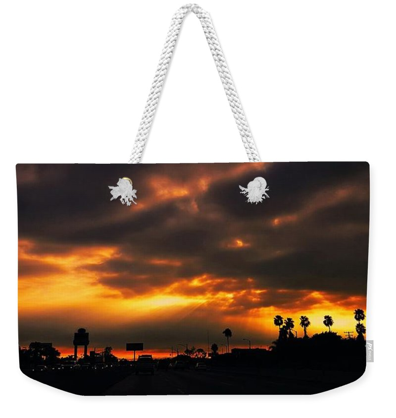 Red Clouds Weekender Tote Bag featuring the photograph Fire From The North by Angela J Wright