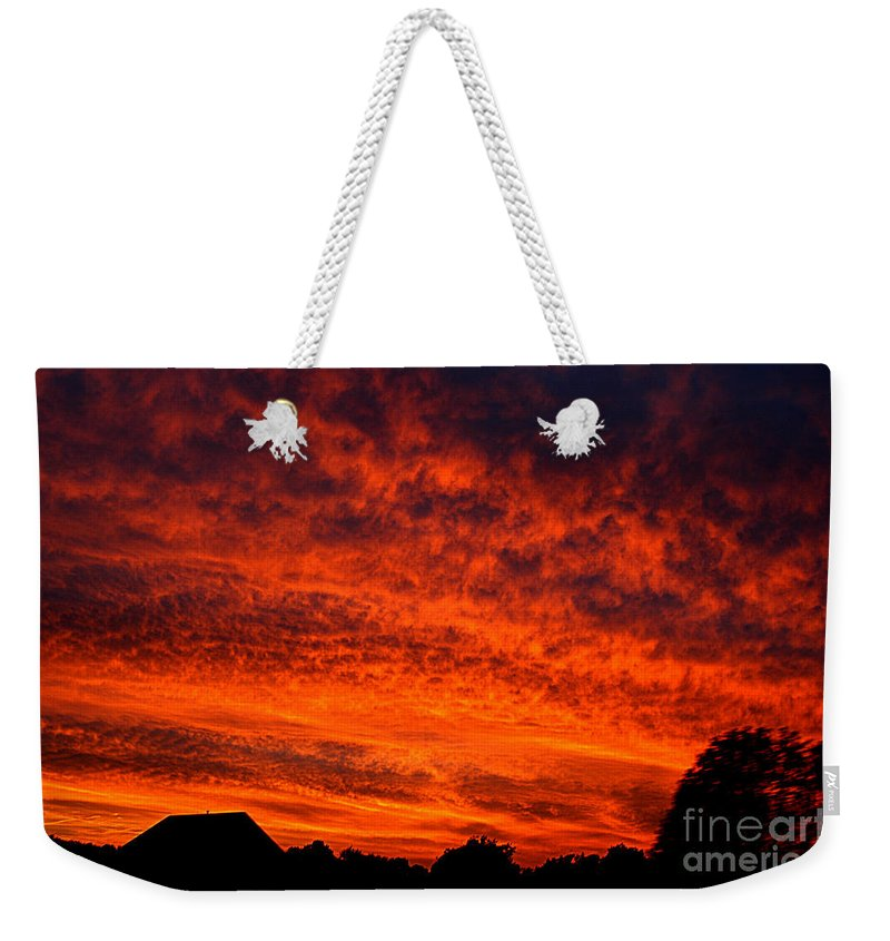 Clay Weekender Tote Bag featuring the photograph Fire In The Sky by Clayton Bruster