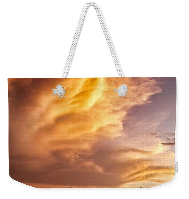 Jamaica Weekender Tote Bag featuring the photograph Fire In The Sky by Dave Bowman