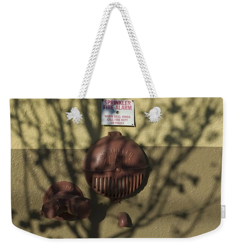 Firebell Weekender Tote Bag featuring the photograph Firebell by Sara Stevenson
