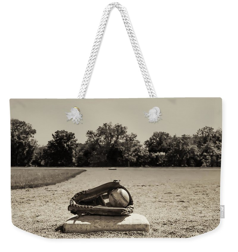 First Weekender Tote Bag featuring the photograph First Base In Sepia by Bill Cannon