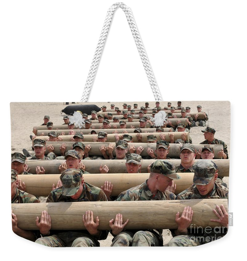 Naval Special Warfare Weekender Tote Bag featuring the photograph First Phase Buds Students Perform Log by Stocktrek Images
