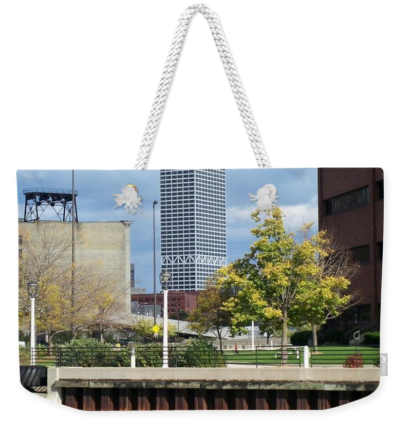 First Star Bank Weekender Tote Bag featuring the photograph First Star Tall View From River by Anita Burgermeister