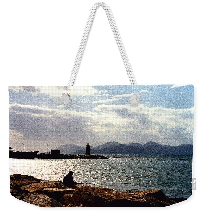 Fisherman Weekender Tote Bag featuring the photograph Fisherman In Nice France by Nancy Mueller