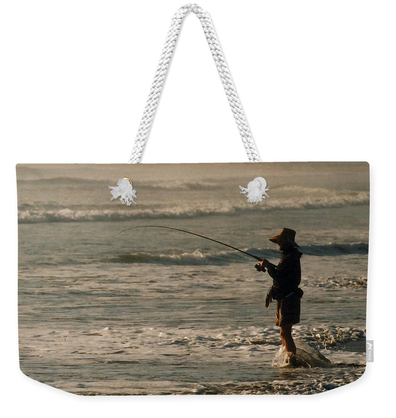 Fisherman Weekender Tote Bag featuring the photograph Fisherman by Steve Karol