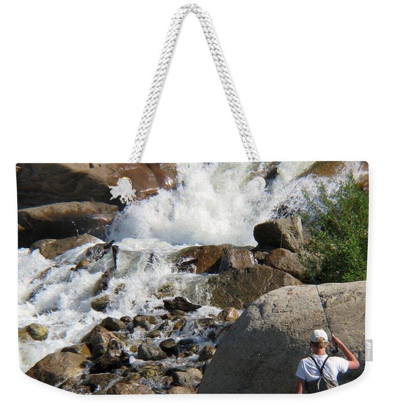 Fishing Weekender Tote Bag featuring the photograph Fishing Anyone by Amanda Barcon
