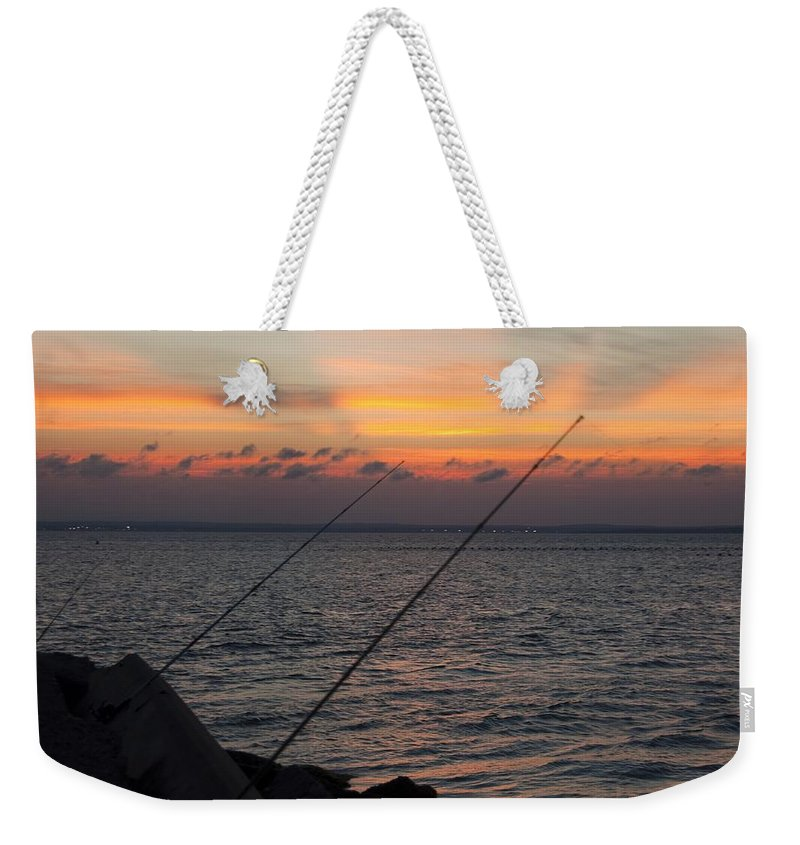 Fishing Weekender Tote Bag featuring the photograph Fishing At Sunset by Steven Natanson