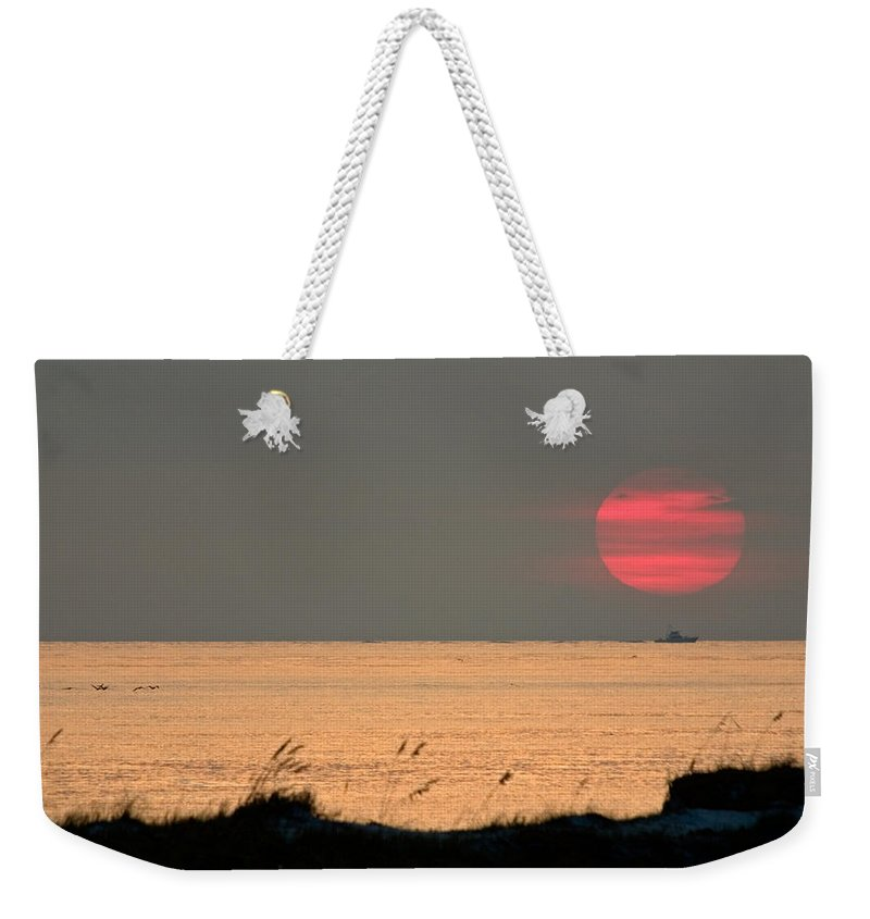 Sun Set Weekender Tote Bag featuring the photograph Fishing Boat Under Setting Sun by John Harmon