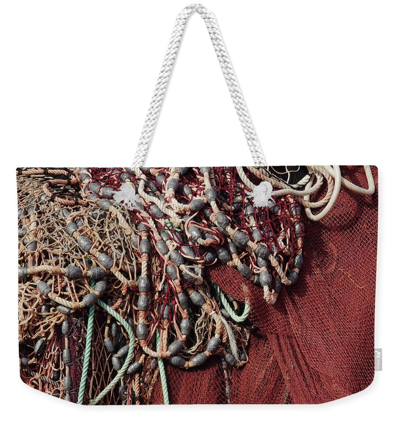 Gear Weekender Tote Bag featuring the photograph Fishing Nets And Led Weights by Carlos Caetano