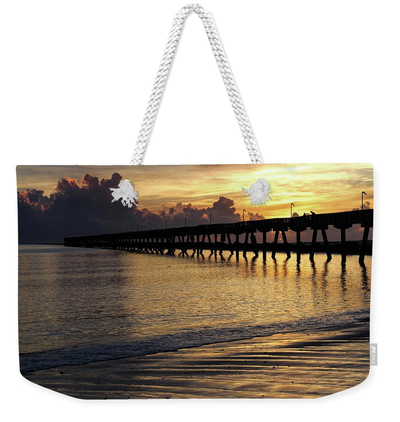 Fort Clinch Weekender Tote Bag featuring the photograph Fishing Pier Sunrise by Timothy Cummiskey