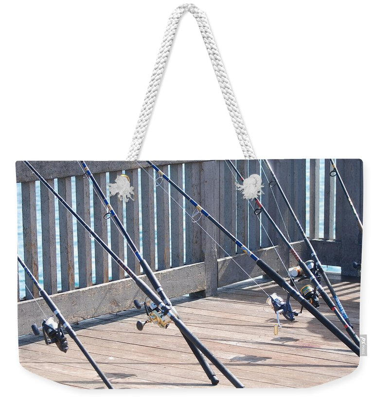 Pier Weekender Tote Bag featuring the photograph Fishing Rods by Rob Hans