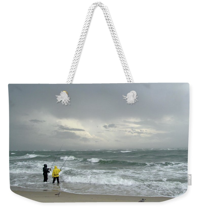 Fishing Weekender Tote Bag featuring the photograph Fishing Through The Storm - Diamond Shoals Nc by Mother Nature