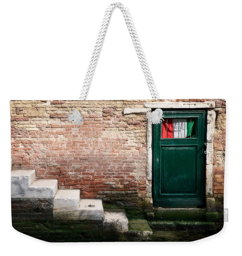 Venice Weekender Tote Bag featuring the photograph Flag by Dave Bowman