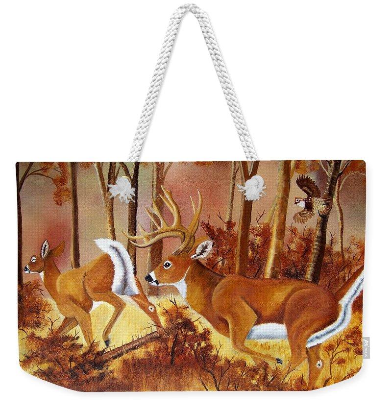 Deer Weekender Tote Bag featuring the painting Flagging Deer by Debbie LaFrance