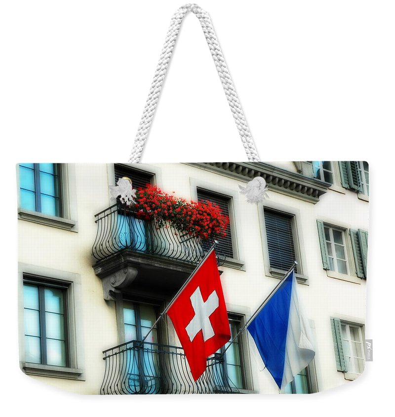 Europe Weekender Tote Bag featuring the photograph Flags Of Switzerland And Zurich by Ginger Wakem